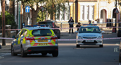 Queens Park, London,October 8th 2015. Police have cordoned off several roads as scene of crime detectives carry out their forensic investigation, following the shooting of a man allegedly armed with a knife, by officers after attempts to taser him failed. The shot man was taken to hospital. PICTURED: A police vehicle appears to have tyre shot out at the scene of the shooting.  Contact: paul@pauldaveycreative.co.uk Mobile 07966 016 296