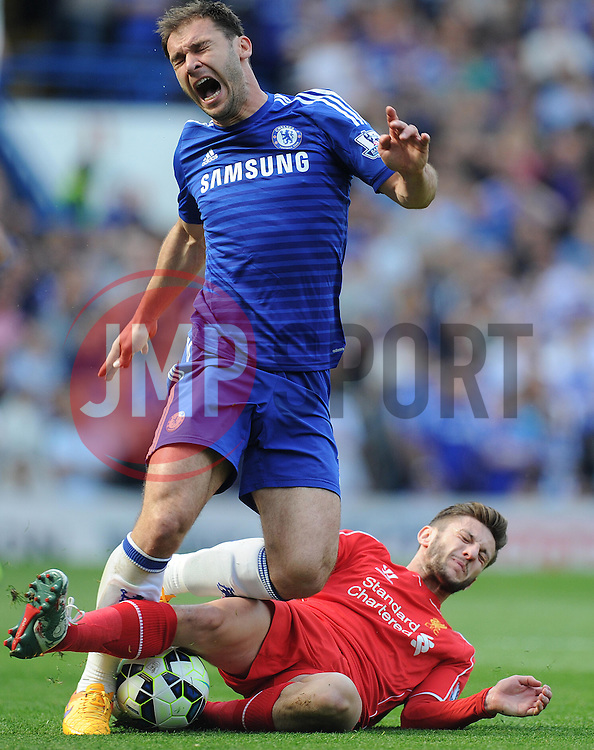 Liverpool's Adam Lallana tackles Chelsea's Branislav Ivanovic - Photo mandatory by-line: Alex James/JMP - Mobile: 07966 386802 - 10/05/2015 - SPORT - Football - London - Stamford Bridge - Chelsea v Liverpool - Barclays Premier League