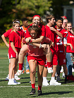 "The senior girls ""piggy back"" team is all smiles during the Homecoming Pep Rally at Laconia High School Friday afternoon.   (Karen Bobotas/for the Laconia Daily Sun)"