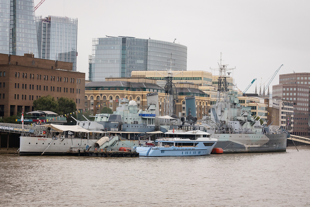 © Licensed to London News Pictures. 16/09/2019. London, UK. Luxury superyacht Ocean Dreamwalker III moors next to HMS Belfast on the River Thames, seen with a helicopter on the helipad at the stern of the yacht during a London visit. 155 feet long long Ocean Dreamwalker III was built in 2018 and is rumoured to be owned by John Deng, a Chinese entrepreneur and politician. It is believed that this is the first time a superyacht has visited the capital with a helicopter onboard. Photo credit: Vickie Flores/LNP