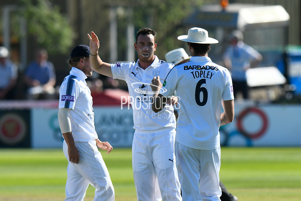 Kyle Abbott of Hampshire celebrates taking the wicket of James Hildreth of Somerset during the Specsavers County Champ Div 1 match between Somerset County Cricket Club and Hampshire County Cricket Club at the Cooper Associates County Ground, Taunton, United Kingdom on 26 May 2017. Photo by Graham Hunt.