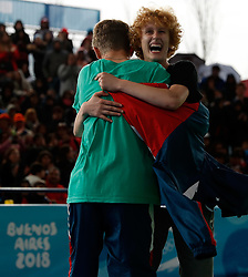 BUENOS AIRES, Oct. 12, 2018  Ella (R) of Austria and Bumblebee of Russia celebrate after winning the breaking mixed team bronze medal battle at the Buenos Aires 2018 Youth Olympic Games in Buenos Aires, Argentina on Oct. 11, 2018. (Credit Image: © Wang Lili/Xinhua via ZUMA Wire)