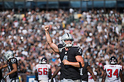Oakland Raiders quarterback Derek Carr (4) celebrates a touchdown against the Atlanta Falcons at Oakland Coliseum in Oakland, Calif., on September 18, 2016. (Stan Olszewski/Special to S.F. Examiner)at Oakland Coliseum in Oakland, Calif., on September 18, 2016. (Stan Olszewski/Special to S.F. Examiner)