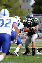 17 September 2011: Cameron Blossom is used as a decoy during a Titans play to draw off the defense during an NCAA Division 3 football game between the Aurora Spartans and the Illinois Wesleyan Titans on Wilder Field inside Tucci Stadium in.Bloomington Illinois.