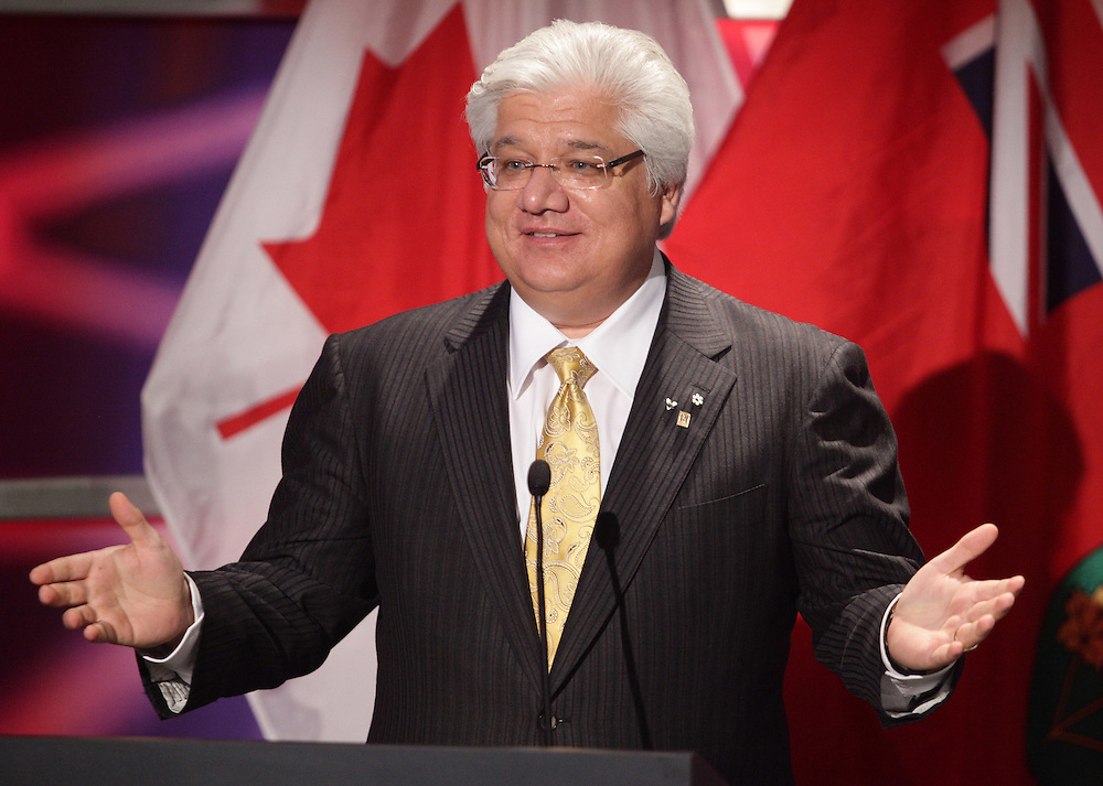 Waterloo, Ontario ---10-06-20--- Mike Lazaridis, the founder of the Perimeter Institute for Theoretical Physics and co-CEO of Research n Motion speaks prior to a lecture by renowned physicist Stephen Hawking in Waterloo, Ontario, Canada, June 20, 2010 where Professor Hawking has recently taken a position as the institute's Distinguished Research Chair.<br /> GEOFF ROBINS AFP