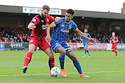 Lyle Taylor forward for AFC Wimbledon (33) and Crawley Town Defender Joe McNerney (5) battle during the Sky Bet League 2 match between AFC Wimbledon and Crawley Town at the Cherry Red Records Stadium, Kingston, England on 16 April 2016. Photo by Stuart Butcher.
