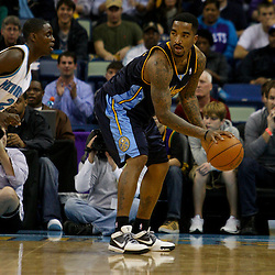 Dec 18, 2009; New Orleans, LA, USA; Denver Nuggets guard J.R. Smith (5) is guarded by New Orleans Hornets guard Darren Collison (2) during the first half at the New Orleans Arena. Mandatory Credit: Derick E. Hingle-US PRESSWIRE