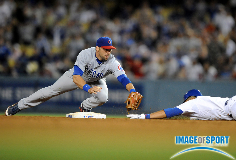 June 2, 2008; Los Angeles, CA, USA; Los Angeles Dodgers center fielder James Loney (7) slides beneath the tag of Chicago Cubs shorstop Ryan Theriot (2) in the ninth inning at Dodger Stadium. The Cubs beat the Dodgers 5-4.
