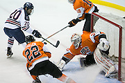 Robert Morris forward Timmy Moore is stopped on the doorstep by RIT goaltender Mike Rotolo during the Atlantic Hockey final at the Blue Cross Arena in Rochester on Saturday, March 19, 2016.