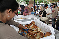 Greek and Nigerian volunteers distributing bread