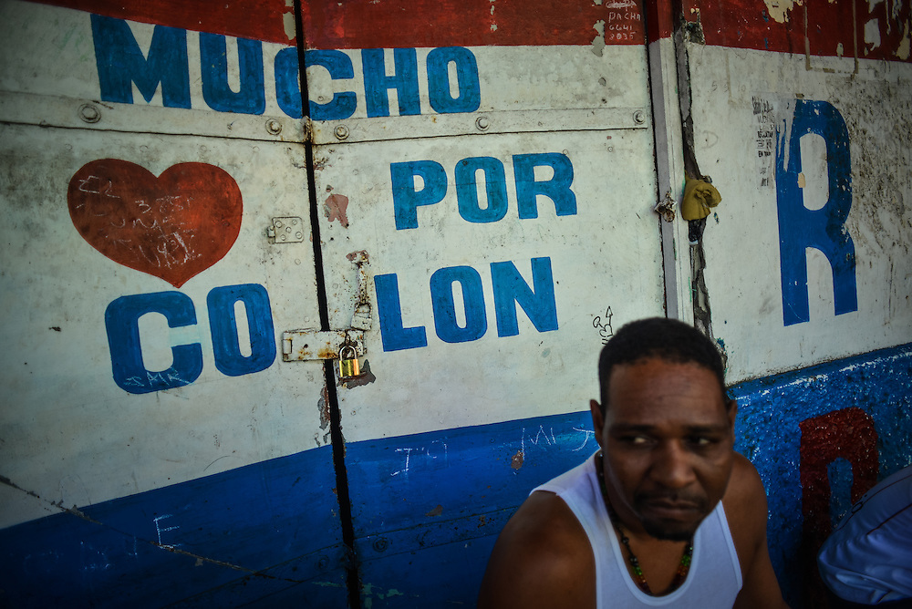 "Doors painted with ""Much love for Colón"" written in Spanish at the entrance to the Wilcox building, which was once an architectural landmark in Colón, is now a condemned building, notorious for being a violent crime hub in the city, with over 100 squatters living inside. Despite being the second largest city in Panama, Colón is one of the poorest in the region, and its residents suffer from a critical shortage of potable water, sewer connections and housing--many people live in condemned or should be condemned buildings. Panama is now one of the fastest growing countries in Latin America and there is a growing resentment and impatience that Colón has not reaped as much of the benefit as Panama City."