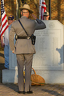 Goshen, New York - A New York State trooper salutes after placing a flower in front the monument during the Orange County Law Enforcement Officer Memorial Service on May 8, 2015, at the entrance of the Orange County Courthouse. The memorial service honors the memory of the members of the Orange County law enforcement community that died in the line of duty. The service also pays tribute the families and loved ones left behind for their courage, dignity and perseverance.