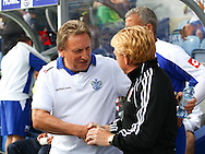 Loftus Road, London - Saturday 11th September 2010: Neil Warnock, manager of QPR and Gordon Strachan, manager of Middlesborough shake hands before the Npower Championship match between Queens Park Rangers and Middlesborough. (Photo by Andrew Tobin/Focus Images)