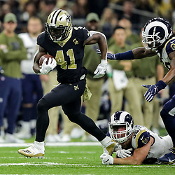 Nov 4, 2018; New Orleans, LA, USA; New Orleans Saints running back Alvin Kamara (41) breaks away from Los Angeles Rams cornerback Dominique Hatfield (36) during the first half at the Mercedes-Benz Superdome. Mandatory Credit: Derick E. Hingle-USA TODAY Sports