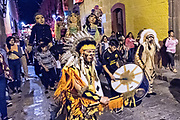 Concheros dancers lead a procession through the historic district during the week long fiesta of the patron saint Saint Michael September 26, 2017 in San Miguel de Allende, Mexico.