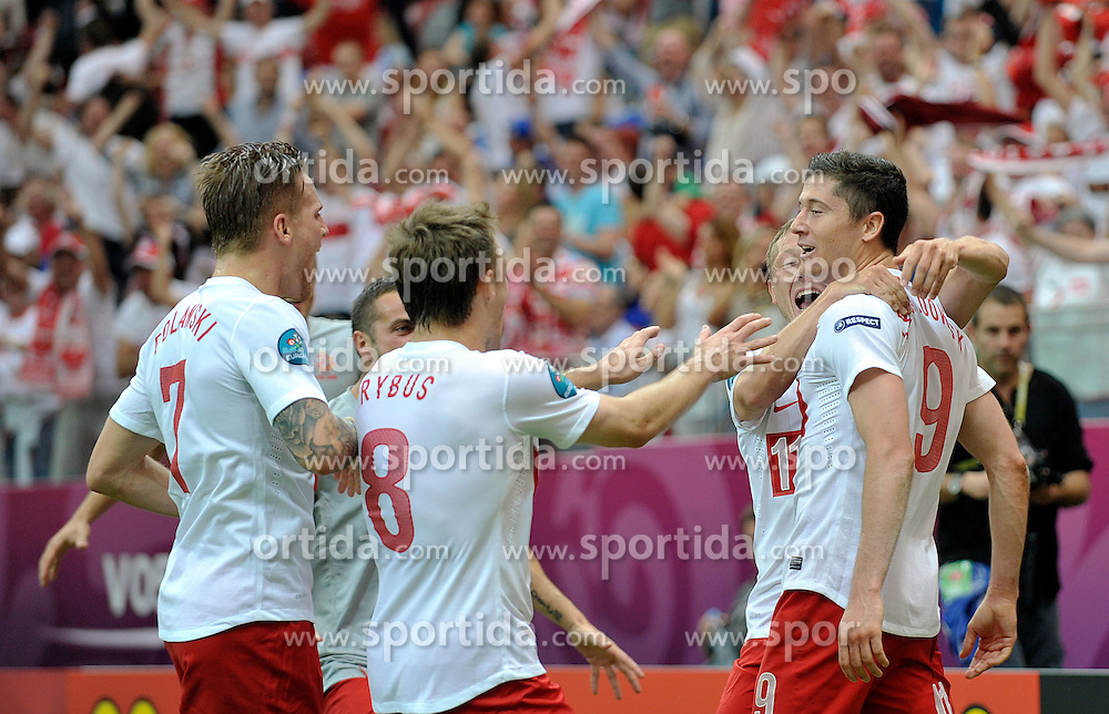 (R) Poland's Robert Lewandowski (nr09) celebrates with team mates after scoring during their the UEFA EURO 2012 Group A football match between Poland and Greece at National Stadium in Warsaw on June 08, 2012....Poland, Warsaw, June 08, 2012..Picture also available in RAW (NEF) or TIFF format on special request...For editorial use only. Any commercial or promotional use requires permission...Photo by © Adam Nurkiewicz / Mediasport