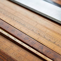 A photograph of a collection of vintage wooden rulers in a private collection