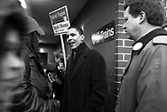 Democratic candidate for the U.S. Senate Barack Obama campaigns at an elevated train stop on the north side of Chicago Monday March 15, 2004. .