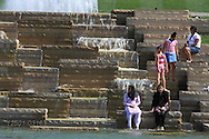 Visitors from a mix of ethnic and racial groups enjoy the fountain and pond below the World's Fair Pavilion in Forest Park; St. Louis, Missouri.