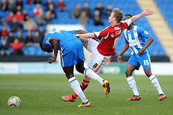 Bristol City's Wade Elliott challenges Colchester United's Magnus Okuuonghae to the ball - Photo mandatory by-line: Dougie Allward/JMP - Mobile: 07966 386802 22/03/2014 - SPORT - FOOTBALL - Colchester - Colchester Community Stadium - Colchester United v Bristol City - Sky Bet League One