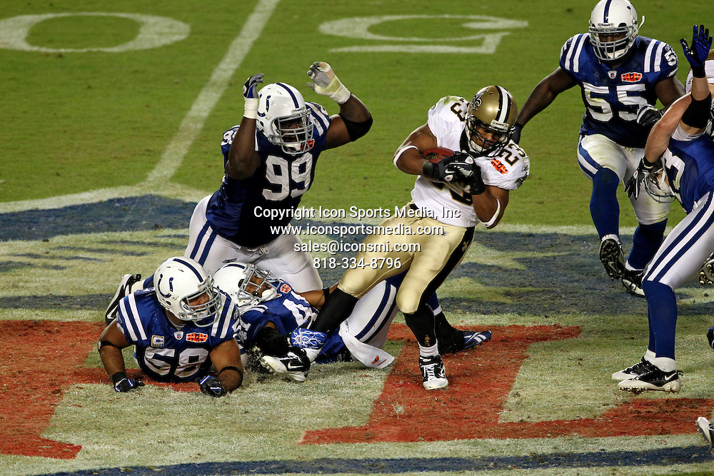 February 07 2010 - Miami Gardens, Florida, USA - The Colts ANTONIO JOHNSON tries to reach for the Saints PIERRE THOMAS in second half action at Super Bowl XLIV at Sun Life Stadium