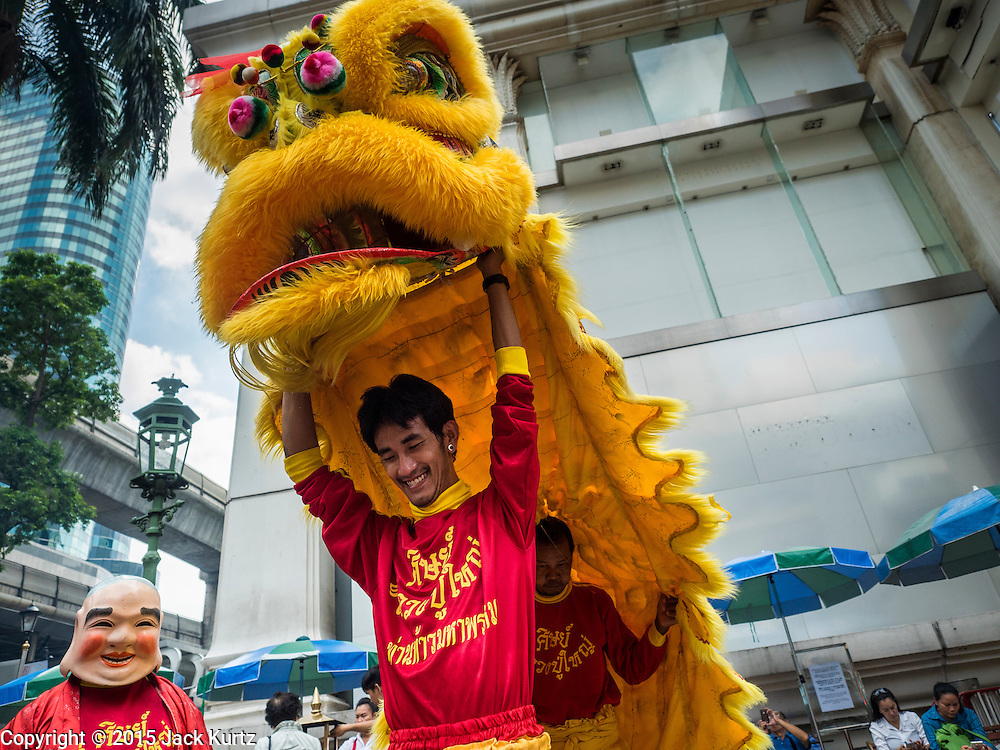 "04 SEPTEMBER 2015 - BANGKOK, THAILAND: Chinese lion dancers perform in a special merit making ceremony at the Erawan Shrine Friday. A ""Holy Religious Ceremony for Wellness and Prosperity of our Nation and Thai People"" was held Friday morning at Erawan Shrine. The ceremony was to regain confidence of the Thai people and foreign visitors, to preserve Thai religious customs and traditions and to promote peace and happiness inThailand. Repairs to Erawan Shrine were completed Thursday, Sept 3 after the shrine was bombed on August 17. Twenty people were killed in the bombing and more than 100 injured. The statue of the Four Faced Brahma in the shrine was damaged by shrapnel and a building at the shrine was damaged by debris.     PHOTO BY JACK KURTZ"