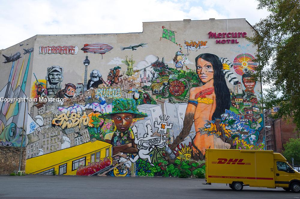 Large street art mural on wall of building in Mitte Berlin Germany