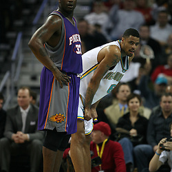 Shaquille O'Neal #32 and Tyson Chandler #6 (right) rest during a free throw attempt on February 26, 2008 at the New Orleans Arena in New Orleans, Louisiana. The New Orleans Hornets defeated the Phoenix Suns 120-103.