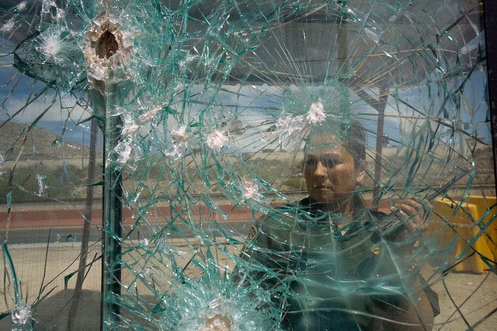 Karla jonson looking at the border between the U.S.A and Mexico next to the city of El- Paso and the Mexican city of Juarez<br /> Monday April  6.2009<br /> Karla is looking to Juarez Mexico throw an armed glass that drug cartels shoot at from the Mexican side of the border.