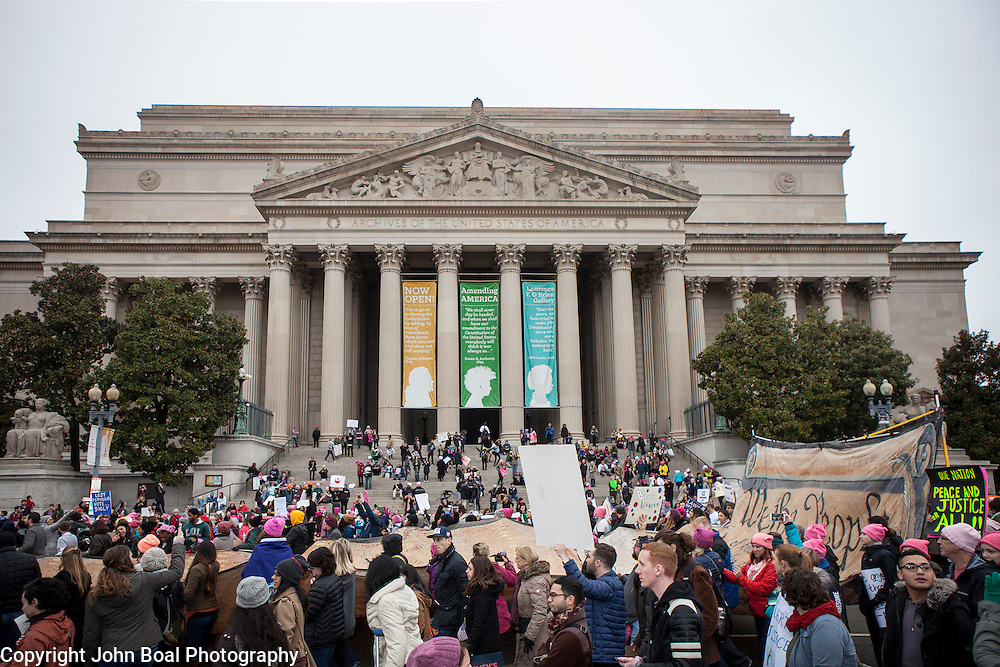 """A makeshift """"constitution"""" filled with thousands of signatures, made it's way down Constitution Avenue, past the National Archives, during the Women's March on Washington where an anticipated 200,000 people turned into an estimated 500,000 to 1 million people, on Saturday, January 21, 2017.  John Boal Photography"""