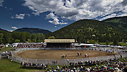 Spectators watch the bronco riding during the 94th Annual Falkland Stampede in Falkland, BC (2012)