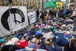 London, UK. 3 May, 2019. Campaigners from Campaign For Nuclear Disarmament (CND), Stop the War Coalition, the Peace Pledge Union, the Quakers and other faith groups stage a die-in opposite Westminster Abbey against the holding of a National Service of Thanksgiving to mark fifty years of the Continuous at Sea Deterrent (CASD) attended by dignitaries including the Duke of Cambridge and the newly appointed Defence Secretary Penny Mordaunt.