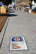 Liechtenstein  Vaduz  June 2008.Printed postage stamps in Stadtle street..