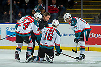 KELOWNA, CANADA - FEBRUARY 12:  Kelowna Rockets' athletic therapist Scott Hoyer tends to Kole Lind #16 with the assistance of Kyle Topping #24 and Dillon Dube #19 of the Kelowna Rockets after a hit by Ralph Jarratt #4 of the Victoria Royals on February 12, 2018 at Prospera Place in Kelowna, British Columbia, Canada.  (Photo by Marissa Baecker/Shoot the Breeze)  *** Local Caption ***
