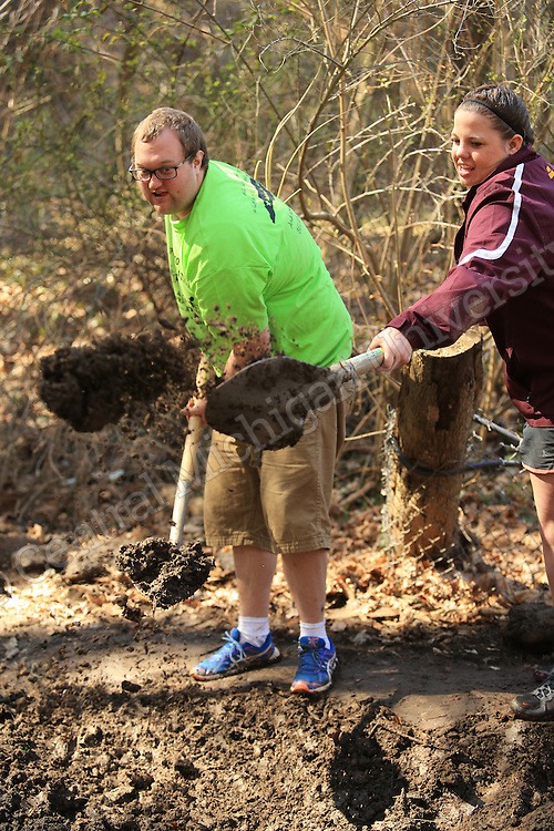 Left to Right-  Justin Bates, of East Lansing, and JaLisa Gorby, of Coldwate work on clearing stream bed. They were among nine CMU students on their Alternative Break who arrived at the YMCA of Western NC Youth Service Center to spend the week to help with projects to improve the center and in the community. They addressed access to sports and recreation and built a kiosk, cleared a stream bed and worked with elementary students in an after school program as their Alternative Break project. CMU is ranked fourth in the nation for the number of students participating in Alternative Breaks and fifth in the country for the most trips coordinated by a university. The program organizes about 40 trips each year with more than 400 students participating. Photo by Steve Jessmore/Central Michigan University
