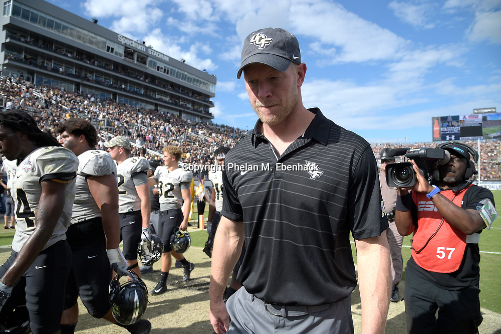 Central Florida head coach Scott Frost walks to the locker room after the first half of the American Athletic Conference championship NCAA college football game against Memphis Saturday, Dec. 2, 2017, in Orlando, Fla. (Photo by Phelan M. Ebenhack)