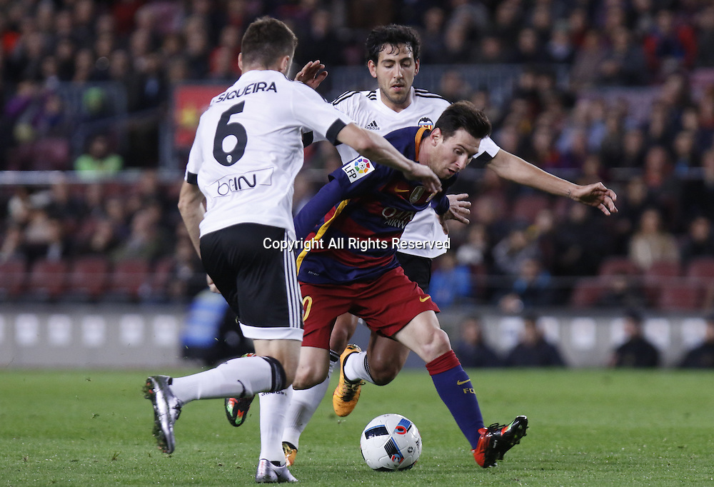 03.02.2016. Camp Nou, Barcelona, Spain. Copa del Rey match between FC Barcelona and Valencia. Leo Messi gets bwteen the two defenders to score