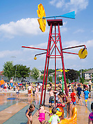Children and adults play at the new Splash Pad located at McKee Farms Park, Fitchburg, Wisconsin, USA