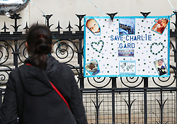 A passer-by looks at a poster in support of Charlie Gard outside the Royal Courts of Justice in London ahead of the latest High Court hearing in a five-month legal battle over whether the terminally-ill baby should be treated by a specialist in America.