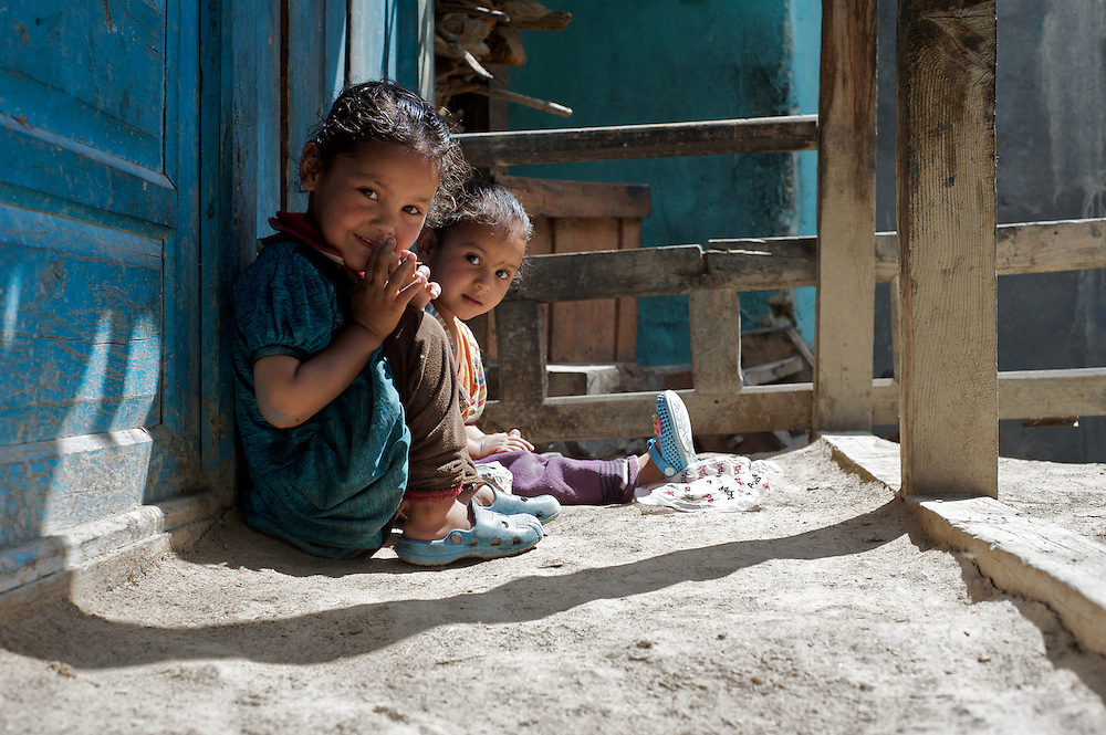 "A child gives a ""namaste,"" a traditional greeting, in the village of Giabong in the Ropa Valley, Himachal Pradesh, India"
