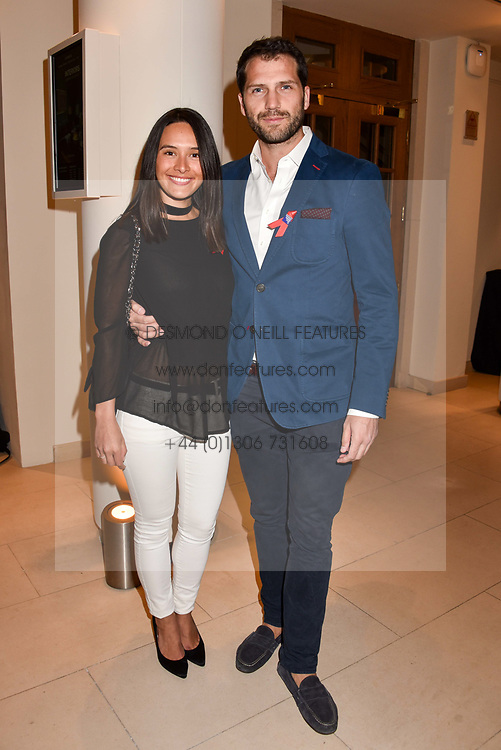 Sophia Tran-Thomson and James Lees-Taylor at the Terence Higgins Trust Auction 2017 at Christie's, 8 King Street, St.James's, London England. 11 April 2017.