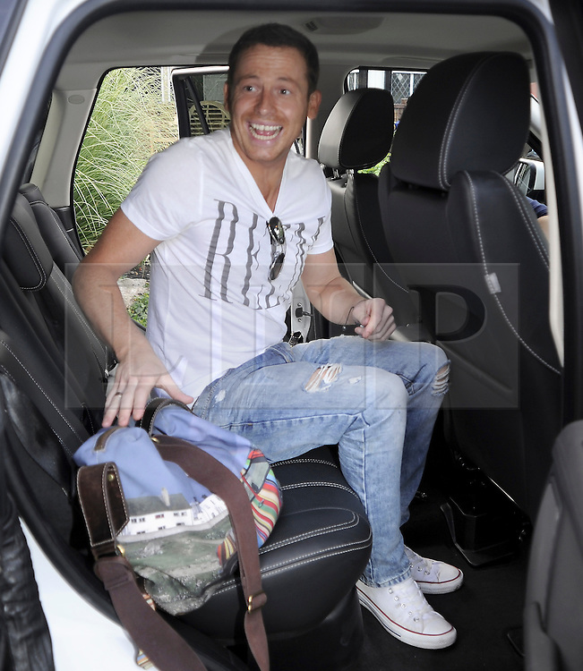 ©  licensed to London News Pictures. 10/06/2011. Cobham, UK. Joe Swash at the start line of  the The Supercar Challenge. Several cars worth more than £2 million in total left from the picturesque Leather Bottle pub, Cobham, for this third annual event which will see contestants take part in a series of challenges on the 1000 mile four day event. See special instructions for details. Picture credit should read Grant Falvey/LNP