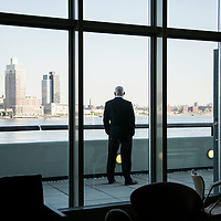 Peter Thomson, President of the seventy-first session of the General Assembly takes a quiet moment at the end of a hectic week of high-level meetings to enjoy the view from his office balcony across the East River to Long Island City.
