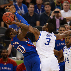 Apr 2, 2012; New Orleans, LA, USA; Kansas Jayhawks guard Tyshawn Taylor (10) shoots as Kentucky Wildcats forward Terrence Jones (3) defends during the second half in the finals of the 2012 NCAA men's basketball Final Four at the Mercedes-Benz Superdome. Mandatory Credit: Derick E. Hingle-US PRESSWIRE
