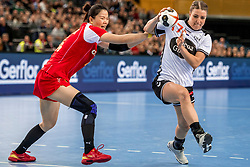 03-12-2017 DEU: 23rd Women World Championship China - Netherlands, Leipzig<br /> Tweede wedstrijd voor Nederland in groep D / Nycke (Cornelia ) Groot #17 of Netherlands, Liu Xiaomei #14 of China