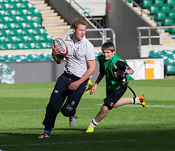 Prince Harry was joined today by former England Rugby player Jason Robinson to take part in the All Schools Event, Twickenham. Twickenham Rugby Stadium, London, United Kingdom. Prince Harry joined schoolboys and girls to play 'TAG' rugby. Thursday, 17th October 2013. Picture by i-Images