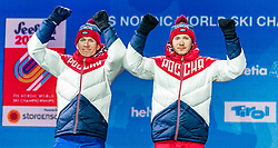 24.02.2019, Medal Plaza, Seefeld, AUT, FIS Weltmeisterschaften Ski Nordisch, Seefeld 2019, Langlauf, Herren, Teambewerb, Siegerehrung, im Bild Silbermedaillengewinner Gleb Retivykh (RUS), Alexander Bolshunov (RUS) // Silver medalist Gleb Retivykh Alexander Bolshunov of Russian Federation during the winner ceremony for the men's cross country team competition of FIS Nordic Ski World Championships 2019 at the Medal Plaza in Seefeld, Austria on 2019/02/24. EXPA Pictures © 2019, PhotoCredit: EXPA/ Stefan Adelsberger