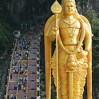 Golden colour Lord Murugan statue in Batu Caves, Malaysia