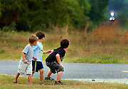 "galmh RACE THE TRAIN---Josiah Kendall, 4, left, Avery Bradley, 4, and Jon Riley Bradley, 6, prepare to race the train from their dirt road near the tracks in Kershaw, SC. Earl and Betty Bradley, their grandparents, have watched their children and grandchildren's fascination with the train for over 20 years. ""It's been great,"" said Betty. ""All our children have grown up with the train."".."