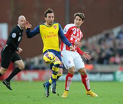 Arsenal's Alexis Sanchez is challenged by Stoke's Bojan Krkic - Photo mandatory by-line: Dougie Allward/JMP - Mobile: 07966 386802 - 06/12/2014 - SPORT - Football - Stoke - Britannia Stadium - Stoke City v Arsenal - Barclays Premie League